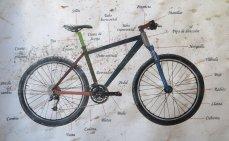 Chez un réparateur de vélo : dico épinglé au mur !